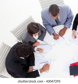 High angle of an international young business people discussing a new strategy in the office
