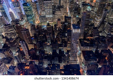 High angle looking down on Manhattan New York City at night.