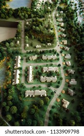 High angle. Miniature scene representing a neighborhood that is going to be built. Blurred edges.