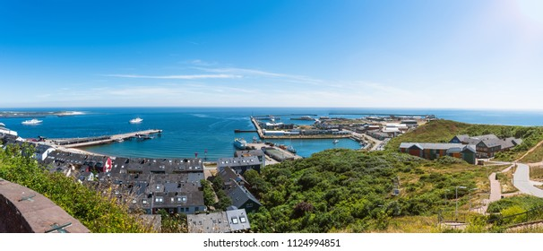 high angle panoramic view of Helgoland Island against blue sea and clear sky