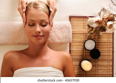 High angle portrait of an attractive female getting recreation massage of head