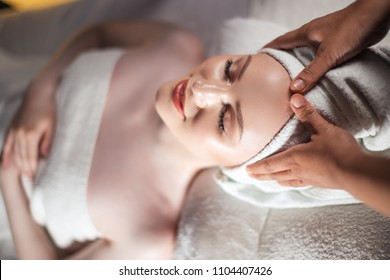 High angle portrait of an attractive woman getting recreation face massage in spa resort