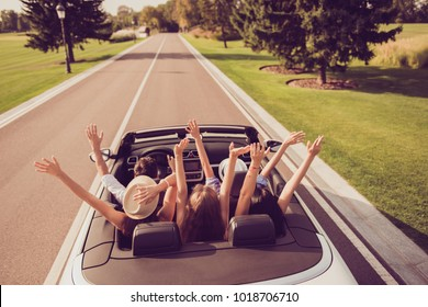 High angle shot of dreamy ladies and guy driver, chics girlfriends in headwear express emotions, success, euphoria, wind. Relax chill destination, vehicle rent, speed ride, students lifestyle