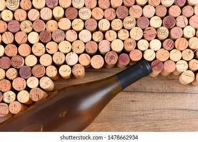 High angle shot of a group of wine corks and Chardonnay bottle on wood table with copy space.