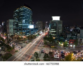 High angle shot of night metropolis Seoul in South Korea. Illuminated buildings and busy city motorways