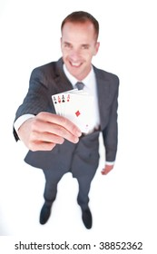 High angle of a smiling businessman holding aces cards