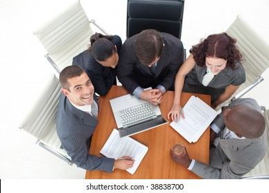 High angle of smiling businessman working with her team in office