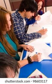 HIgh angle take of students at a desk