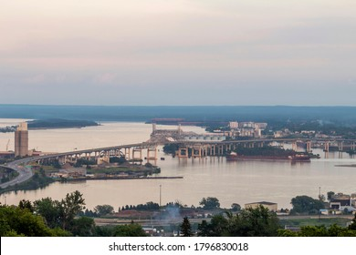 """A High Angle Telephoto Shot of a """"Laker"""" Departing the Duluth Harbor Passing under the Blatnik Bridge on a Summer Evening"""
