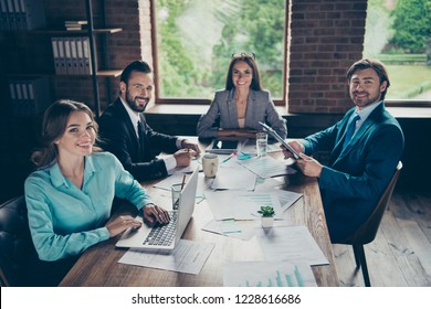 High angle top view of four attractive employer employment entrepreneur finance analyst accountant advocate agent person sit on chair indoor loft interior look at camera make toothy white smile
