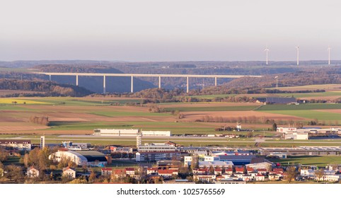 high angle view around a hill named Einkorn near Schwaebisch Hall including the Kocher Viaduct and a small airport