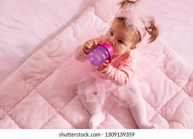 High angle view of a baby girl wearing pink tutu skirt f06f574ef710
