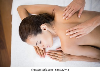 High angle view of beautiful woman receiving back massage at health spa