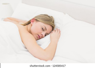 High angle view of beautiful young woman sleeping in bed at home
