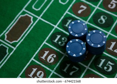 High angle view of blue chips on roulette table