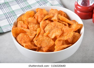 High angle view of a bowl of barbecue flavored potato chips.