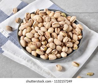 High angle view of a bowl of fresh organic pistachios