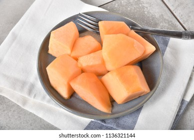 High angle view of a bowl plate of sliced cantaloupe