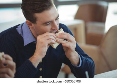High angle view of businessman having breakfast at at office cafeteria