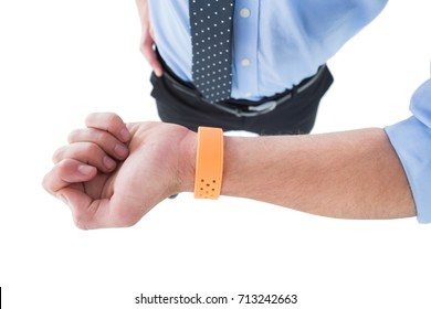High angle view of businessman wearing smart watch while standing against white backgorund