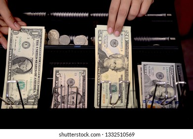 High angle view of cashier searching for change in cash