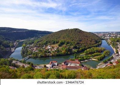 High angle view from the Citadel of a loop of the Doubs River around the Chaudanne Mount, with the Velotte neighborhood on the left and the Gare d'Eau on the right, Besançon, France