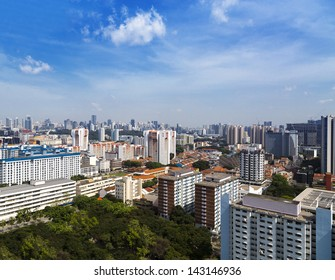 High angle view of a cluster of colourful flats in residential District next to a park- Singapore