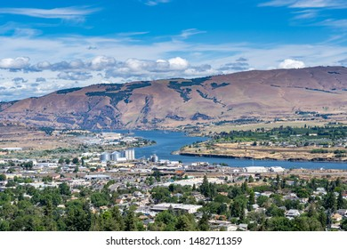 A high angle view of the columbia river and city of the dalles industrial area