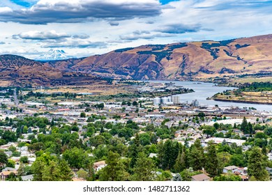 A high angle view of the columbia river,  city of the dalles industrial area, and Mt Adams.