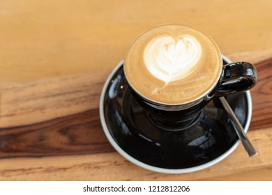 High angle view a cup of hot cappuccino coffee on wood table
