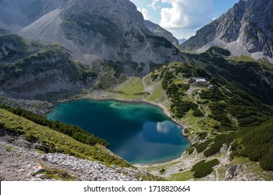 a high angle view of Drachensee lake and mountain cabin