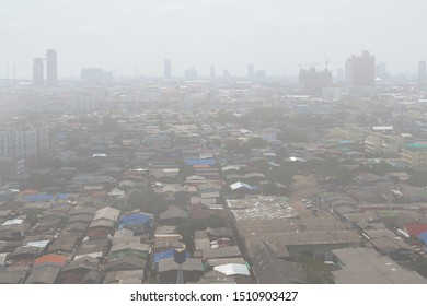 High angle view drone picture, Group of homestead and mixed roof house in Bangkok capital city of Thailand with haze or smoke around area. Background for PM 2.5 micro dusty pollution problem in town.