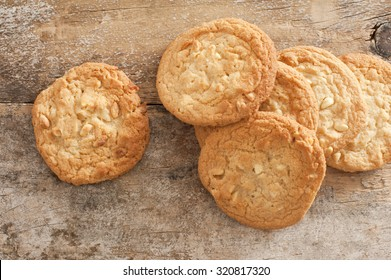 High Angle View of Fresh Baked Cookies Scattered on Rustic Wooden Background