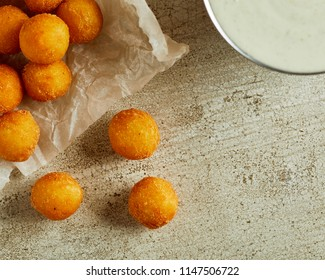 High angle view of fresh homemade cheese balls on wooden cutting board