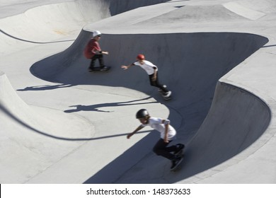 High angle view of friends skateboarding in park