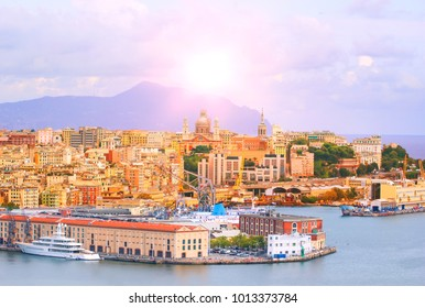 High angle view of Genoa (Genova) city with sea view and yachts under the bright sun in natural background.