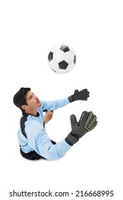High angle view of goal keeper in action over white background