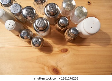 high angle view group salt and pepper shakers on the wooden table