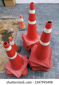 High Angle View of Group of Stacked Orange Traffic Road Cones
