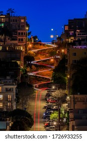 High angle view of illuminated homes on the famous Lombard Street, San Francisco California at sunset, long exposure car light trails and light bursts