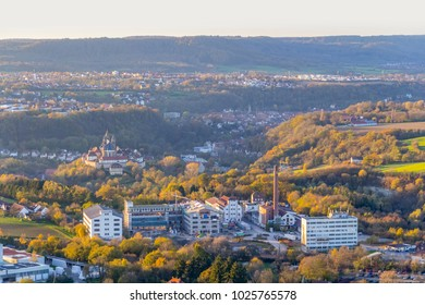 high angle view including the Comburg seen from a hill named Einkorn near Schwaebisch Hall in the evening at autumn time