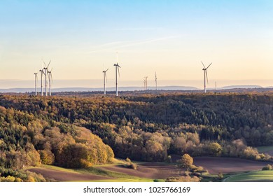 high angle view including a wind farm around a hill named Einkorn near Schwaebisch Hall in the evening at autumn time