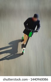 High angle view of man on kick scooter in blurred motion