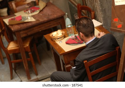 High angle view of a man sitting in a cafe, Siena, Tuscany, Italy,