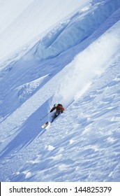 High angle view of man skiing on steep slope