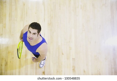 High angle view of man with Squash racket