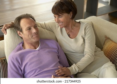 High angle view of a mature couple sitting on a couch