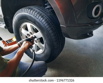High Angle View of Mechanic Changing Front Wheel Tire