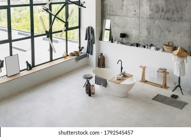 High angle view of modern interior at contemporary bathroom, folded clean towels on wooden shelf at empty bath near cotton bathrobe and house decor with copy space on concrete floor
