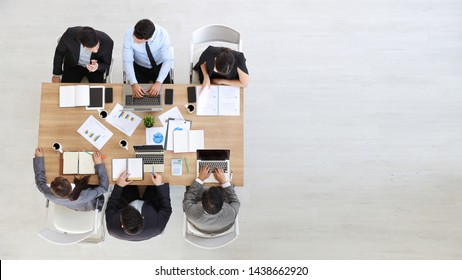 high angle view of multiethnic business people working office desk with right copy space